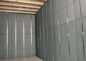 SilverGlo™ insulation and metal studs making up our Basement to Beautiful™ panels.  Installed in Brainerd.